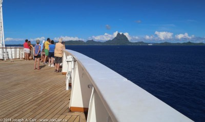 Passengers on the bow as Statendam approaches Bora Bora