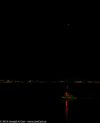 Venus rising in the east before sunrise with the pilot boat beside us, as we approach San Diego