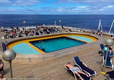 Sea View pool and blue skies, lots of sunbathers