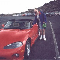 Jim beside a Dodge Viper