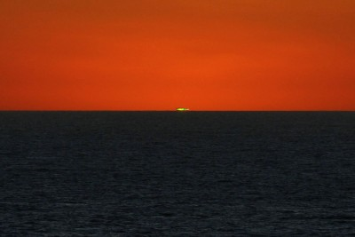The green flash captured at sunset from the Deck of the Rotterdam Cruise ship
