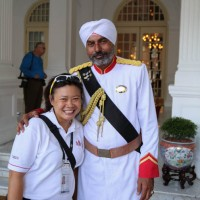 Our guide with the doorman in the entrance, Raffles Hotel, Singapore