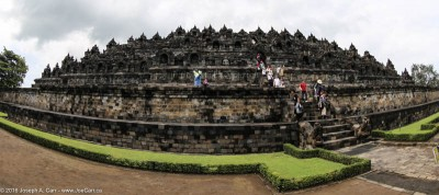 Hundreds of Buddha statues looking back to the Borobudur temple Java, Indonesia