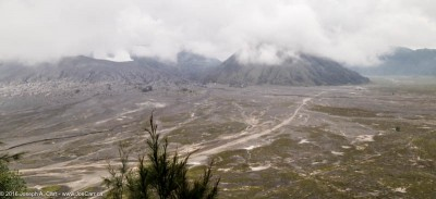 Cloud-shrouded Mount Bromo and the Sea of Sand, Cemoro Lawing, Java, Indonesia