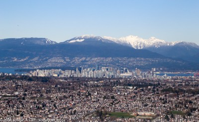 Looking North across the city of Vancouver to the North Shore mountains on final approach to Vancouver airport