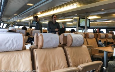 Serving staff and lots of empty seats in the main cabin