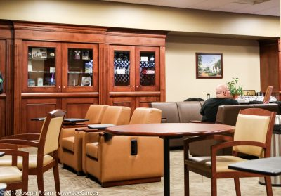 Tables, chairs, loungers and a bookcase in the Metropolitan Lounge, LA's Union Station