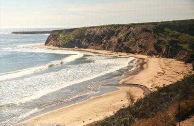Sandy crescent beach and cliffs of Cojo Bay on the California coast