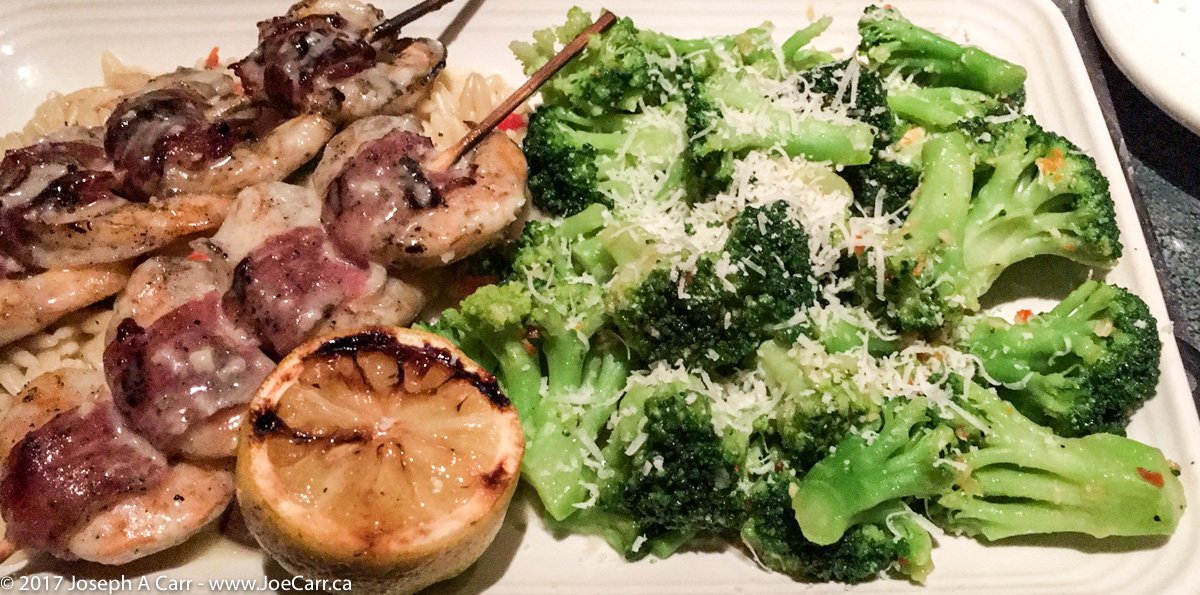 Proscuitto-wrapped shrimp with broccoli