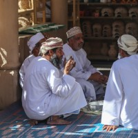 Men drinking tea or coffee in the Nizwa Souq