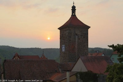Tower, rooftops and the setting sun over Rothenburg