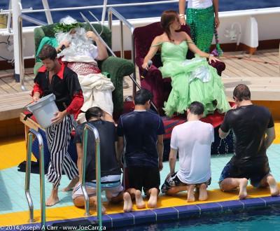 Polywogs kneeling before King Neptune