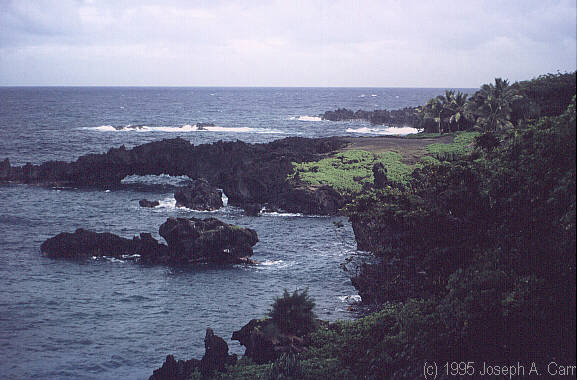 Spectacular natural arches along the shoreline near Waianapanapa State Park