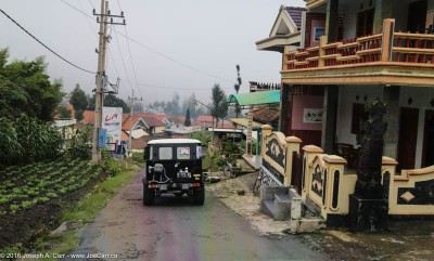 Jeeps descending through a village near Mt. Bromo, Java, Indonesia