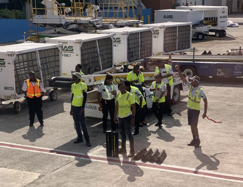 Airport ground crew waiting for clearance to unload the aircraft WestJet at Montego Bay