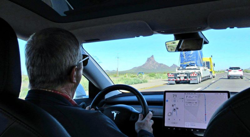 Joe driving the Tesla Model 3 north back to Phoenix as we pass Picacho Mountain